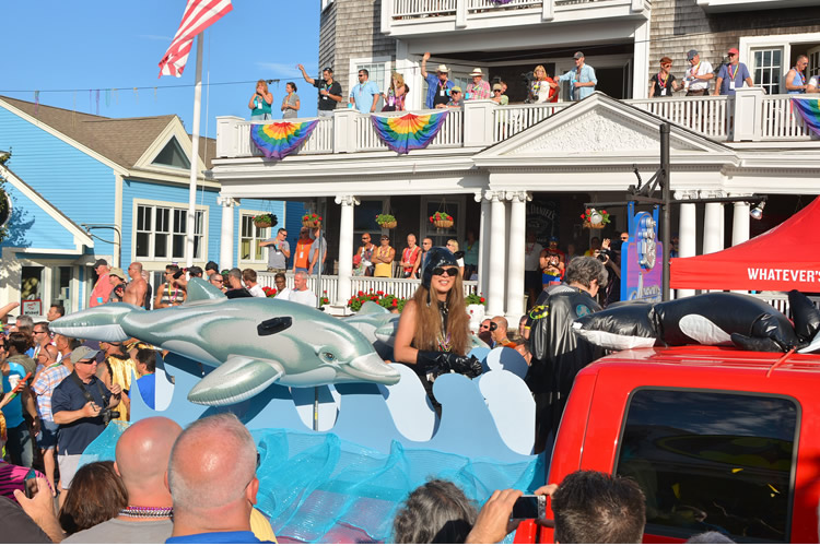 Dolphin float pulled by a red truck on Carnival Parade