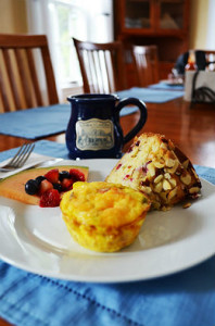 A plate of some of our breakfast selections, such as our Admiral's Cup, Cranberry Almond Cake and some fresh fruit.