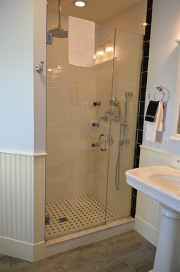 Room 3 has a separate spa shower and heated floors
