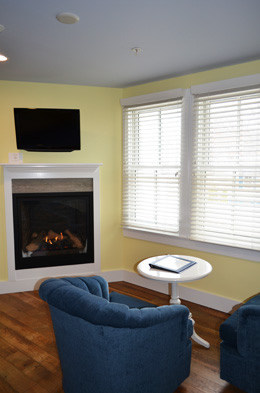 A comfy seating area for 2 and gas fireplace to keep you warm on those chilly nights